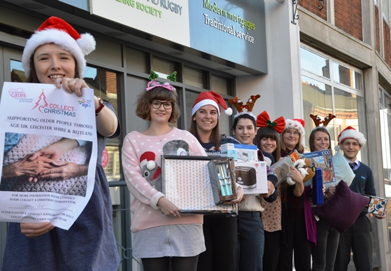 Staff with donations for 2015's Collect for Christmas campaign for Age UK