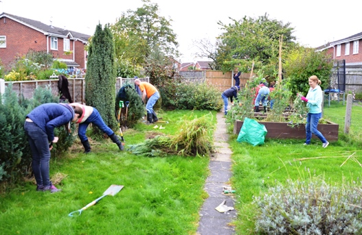 Volunteers in action on day one of the team challenge at Barwell Community House