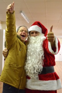 A volunteer Santa with one of the centre's members.