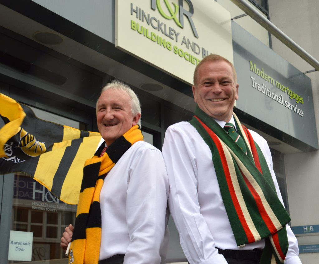Photo shows Hinckley & Rugby's chief executive Chris White and new operations director Dean Waddingham making clear their rugby allegiances with supporters scarves.