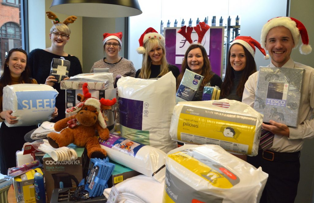 A team from the Society with the many items donated by Society employees for the annual Collect for Christmas Campaign