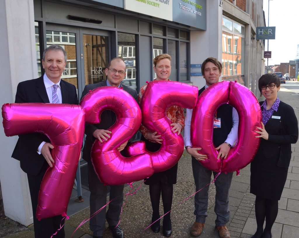 Society staff celebrate their donation of £7,250 to each of the three local hospices