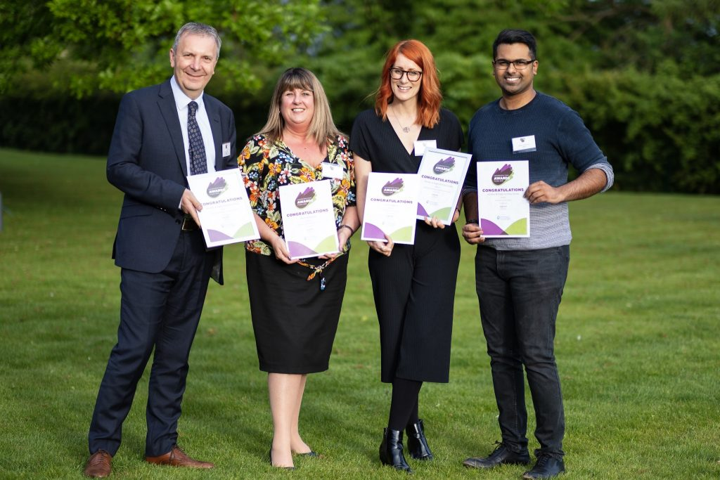 Hinckley & Rugby employees show off their Leicestershire Cares awards